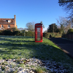 Red telephone box at Stonebridge Green